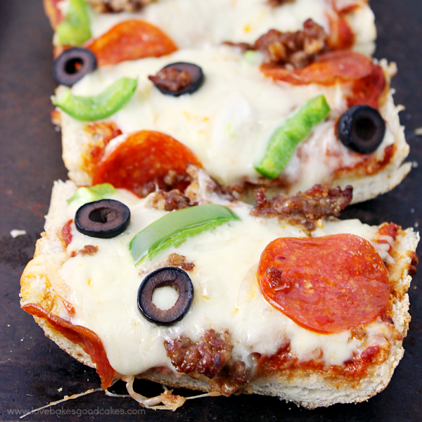 French Bread Pizza sliced on a baking sheet close up.