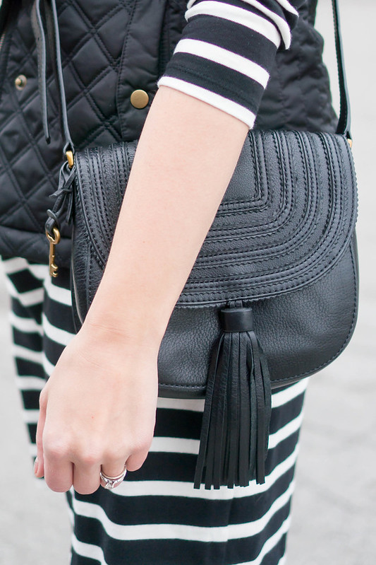 black white stripe dress + black vest + black tassel crossbody purse + black and red buffalo plaid scarf | Style On Target blog