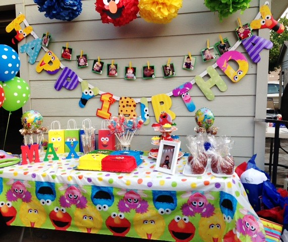 Sesame street party cake table this colorful and fun for Backyard party decoration crossword