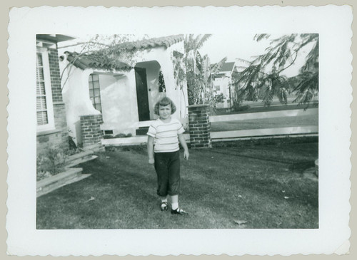 Girl in front yard