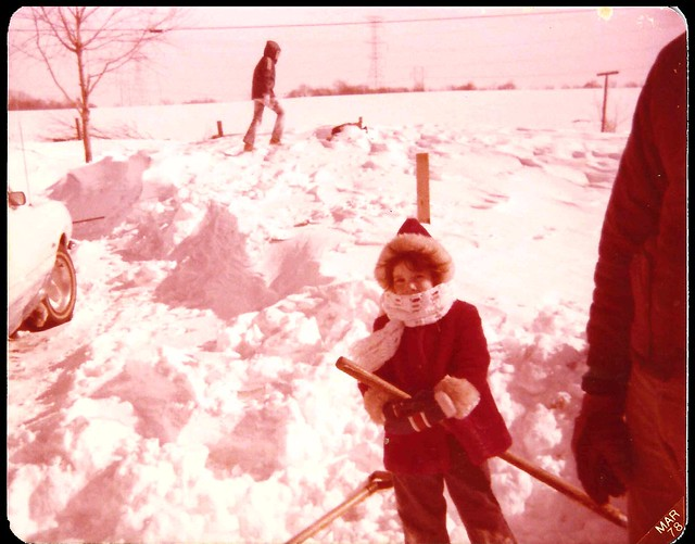 My 5 year old sister, Julie, helps my dad with the snow clearing around my grandma's 76 Ford Maverick.