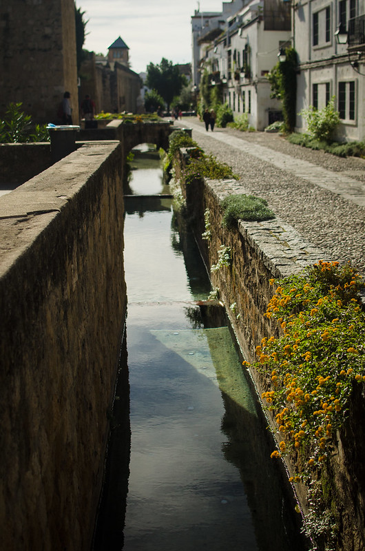 A canal leads the way to the historic center of Córdoba, Spain.