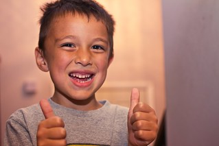 A boy gives a thumbs up