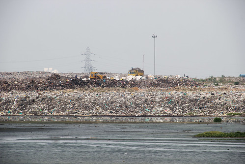 The Perungudi solid waste dump yard slowly eats into the marshland.