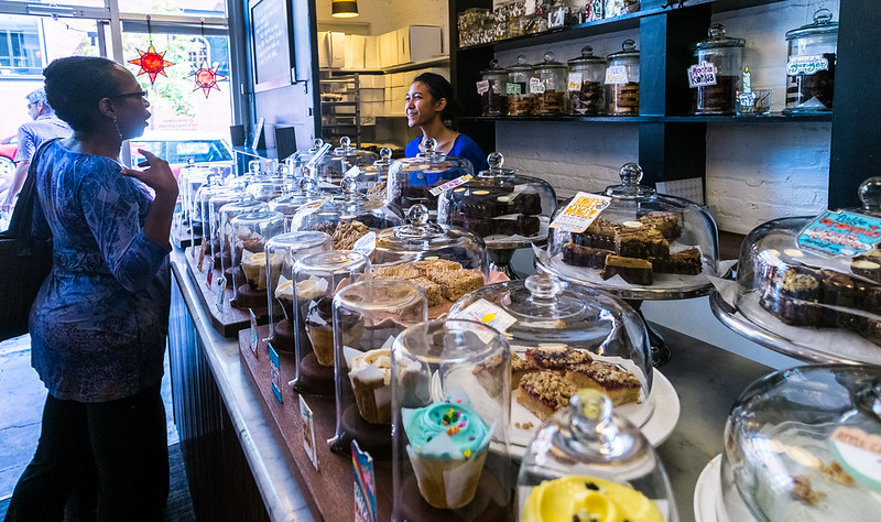 Cupcakes on display inside Baked & Wired. Photo: ehpien, CC