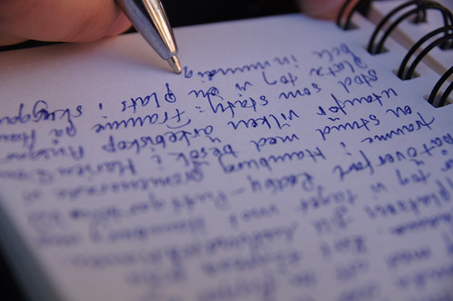 A closeup of a pen on a page of written text