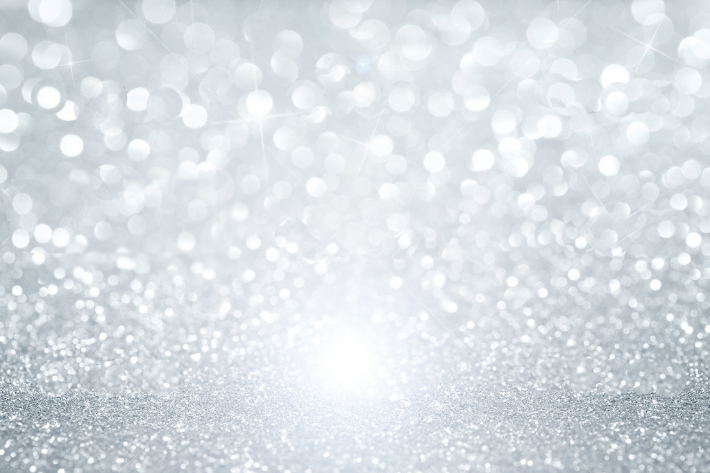 Abstract Silver Defocused Glitter Background With Copy Spa