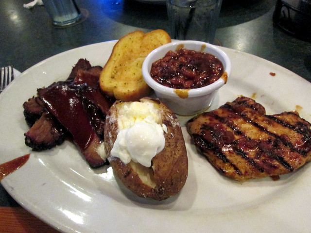 Beef Brisket, BBQ Chicken, Baked Potato, Baked Beans And Garlic Toast.