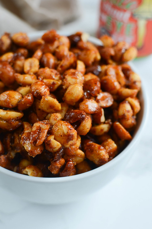 Slow Cooker Sweet and Spicy Peanuts - easy and delicious party snack! Peanuts cooked in butter, brown sugar, sriracha, and chili powder! So addictive!