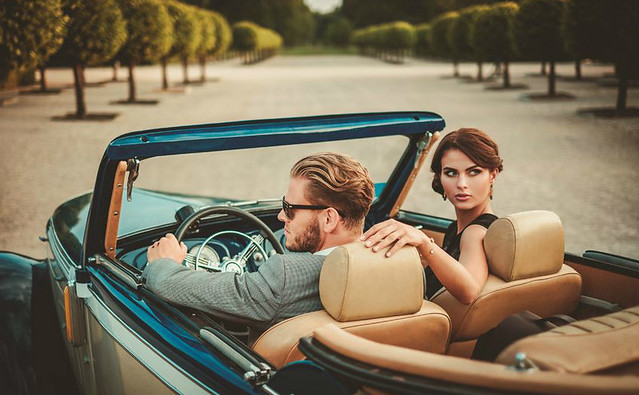 Young Couple in Vintage Car asset management industry trends