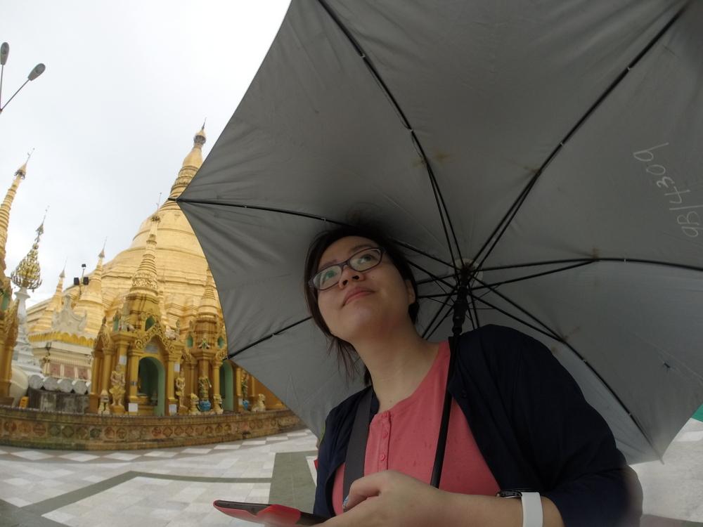 Disadvantages of visiting Myanmar during rainy season: Under my umbrella