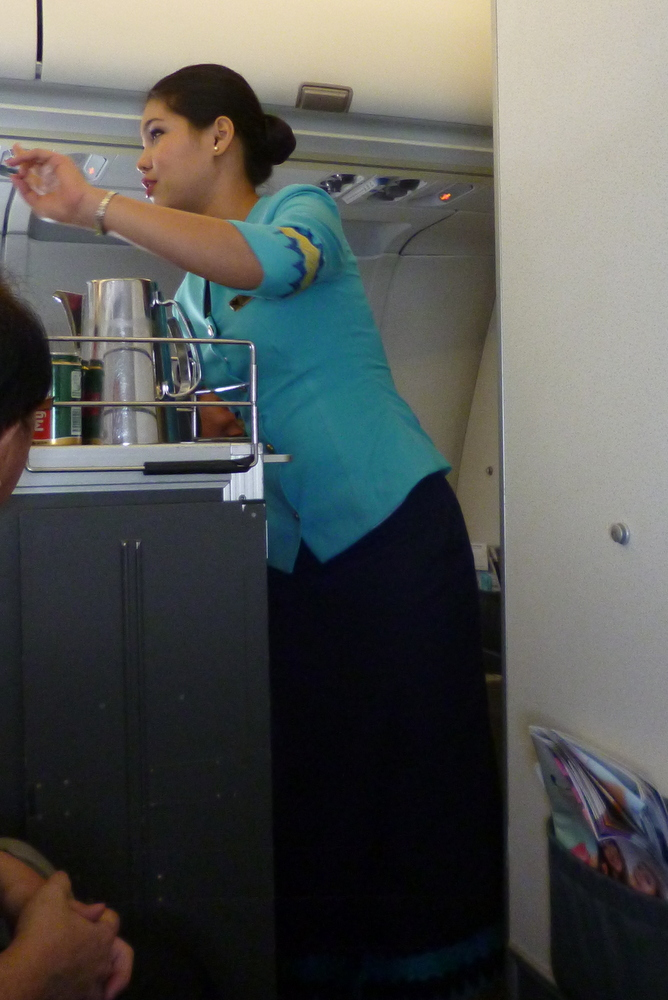 MAI cabin crew wearing traditional longyi