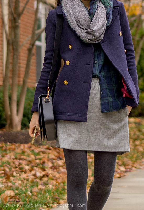 plaid and herringbone infinity scarf, navy peacoat, plaid button up shirt, gray wool skirt, tights