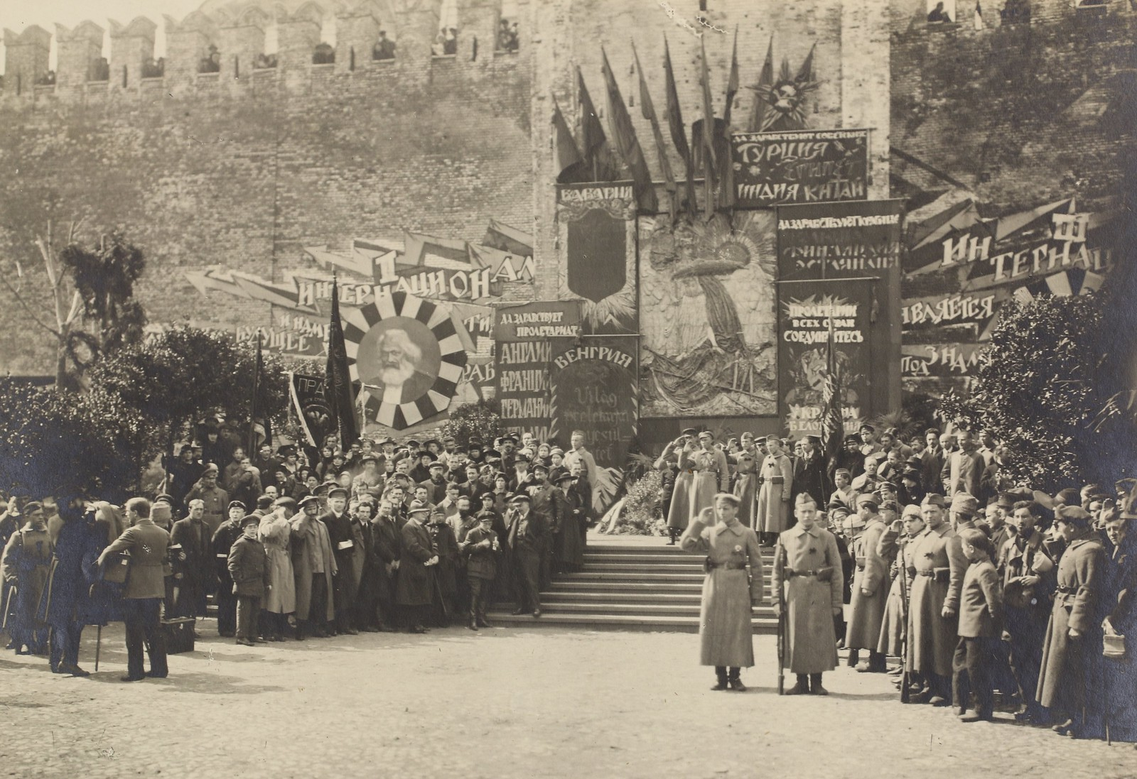 """""""Lenin with comrades at a May Day rally in Red Square, May 1919""""   by The Graduate Institute, Geneva"""