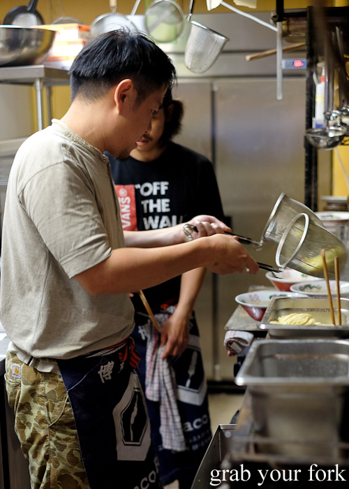 Chef Keita Abe draining cooked ramen noodles at Chaco Bar, Darlinghurst