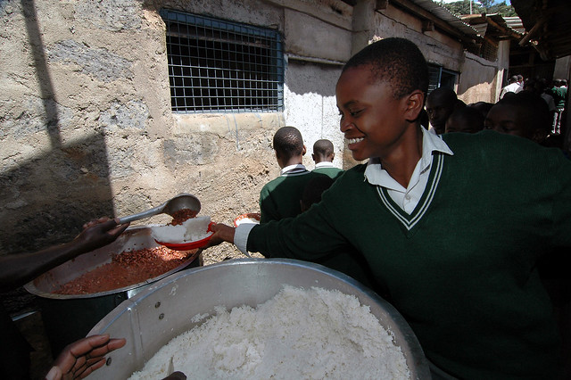 School lunch of rice and beans in Africa
