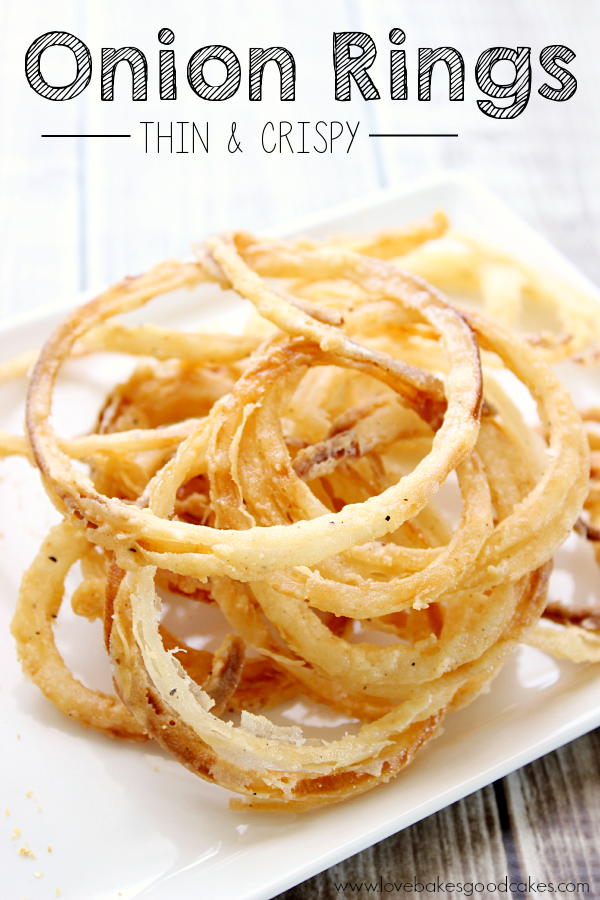 Onion Rings - Thin and Crispy on a white plate.