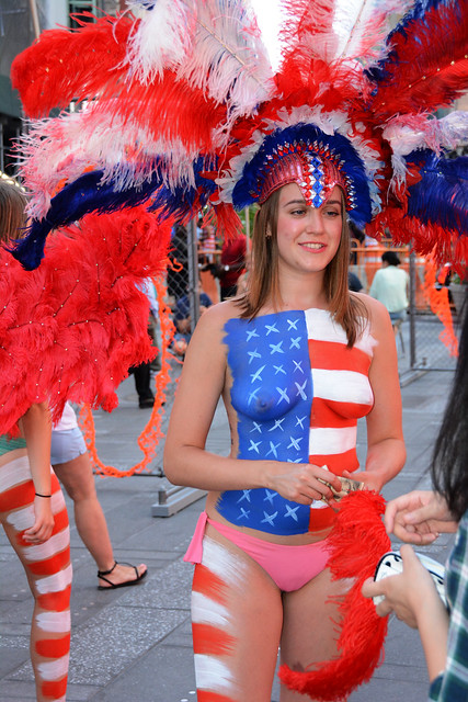 women in times square in nyc wearing only body paint
