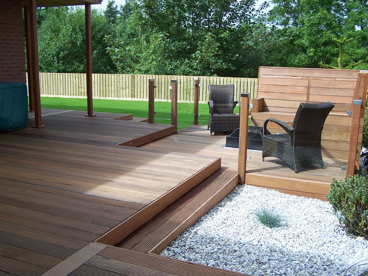 Glass balustrade with timber posts if you use this image for Garden decking and slabs
