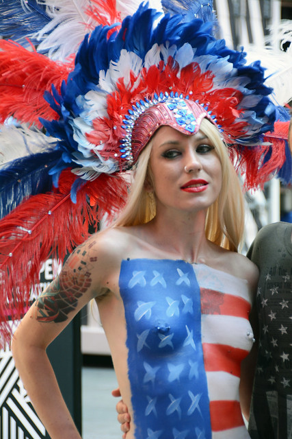 Women in times square in nyc wearing only body paint for Painting jobs nyc