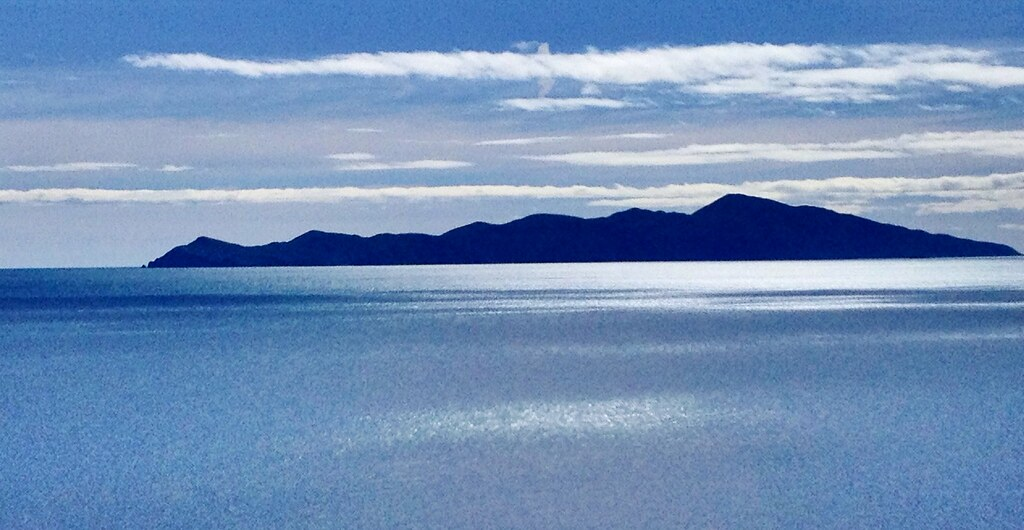 Kapiti Island Silhouetted Against The Morning Sun Near Puk