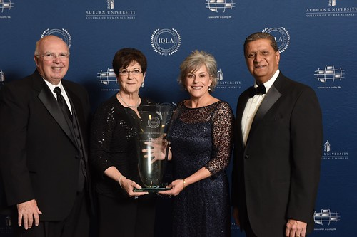 Tim Boosinger, June Henton, Beth Thorne Stukes and Amir Dossal pose for a photo at the IQLA ceremony.