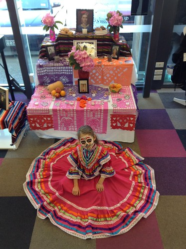 Day of the Dead display and girl in costume