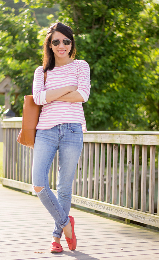 pink and white striped top, light wash jeans, red loafers, cognac brown tote