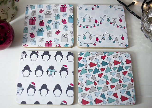 Handmade decoupaged coasters by StickerKitten using Penguins and Presents papers. Available on Etsy (search StickerKittenDesign).