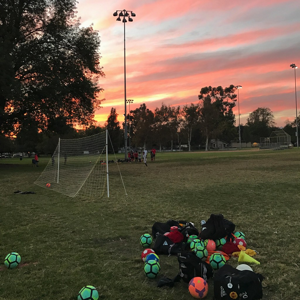 Soccer practice at sunset