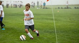 Ten year old boy playing soccerr