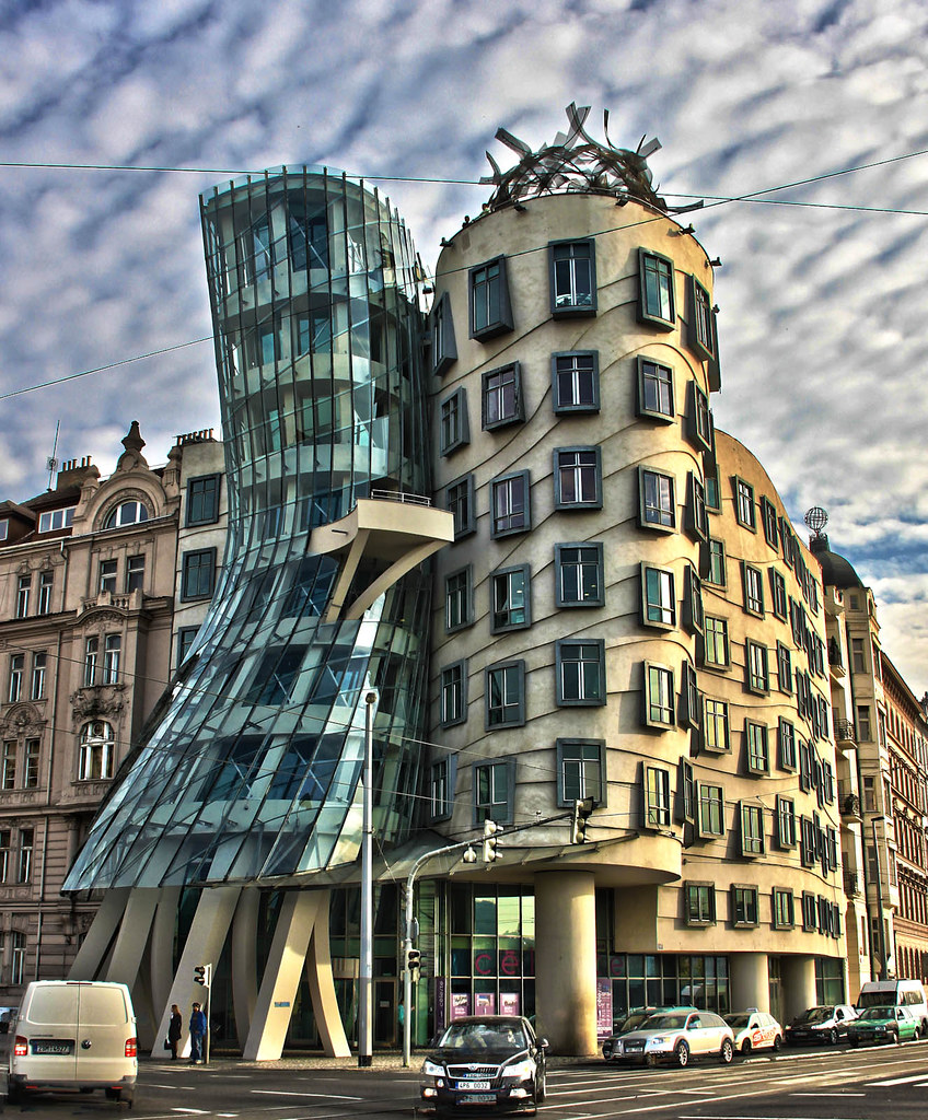 dancing house It may sound crazy to you – a house that dances impossible but it is real it's a building of a very unusual shape - you can actually see a couple - woman and man dancing together, holding their hands, with a skirt that sways to the music.