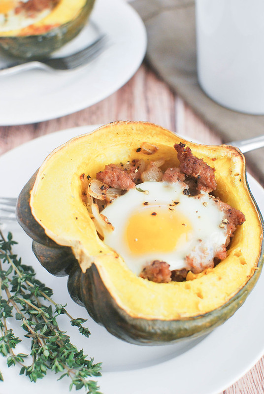 Breakfast Stuffed Acorn Squash - healthy and delicious breakfast! Roasted acorn squash filled with sausage and topped with an egg!