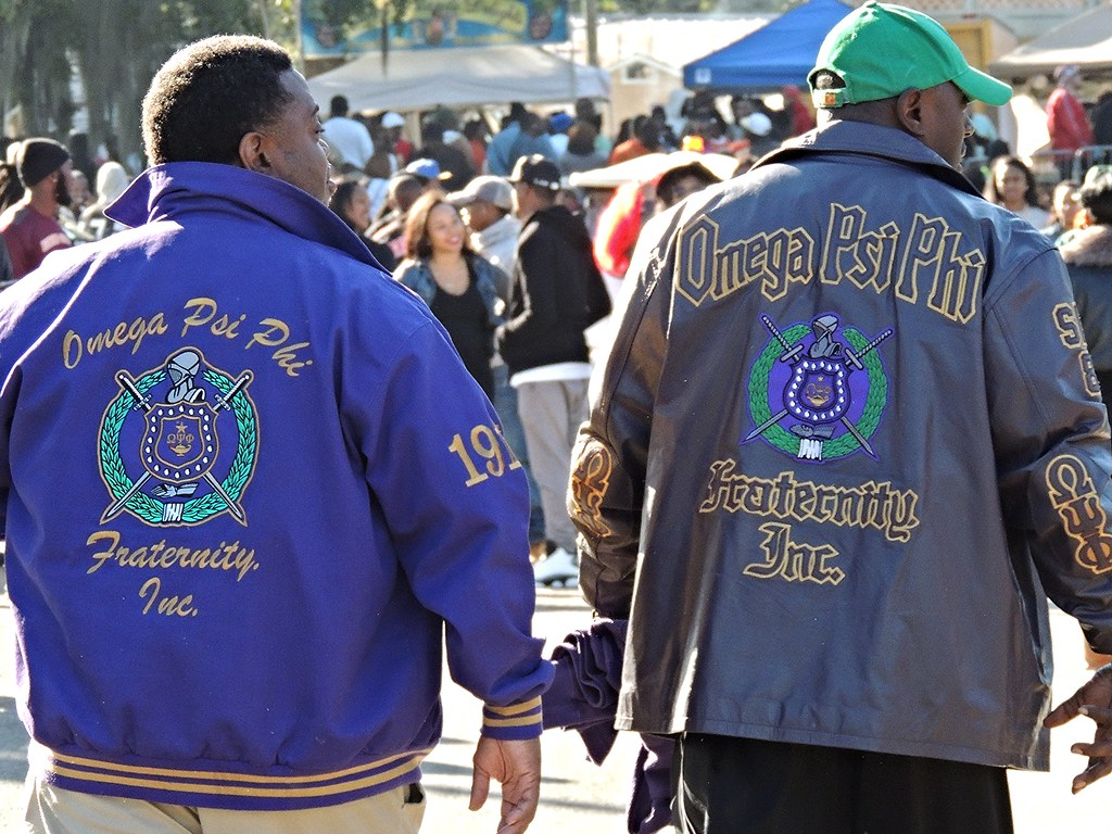 brothers wearing their omega psi phi fraternity jackets