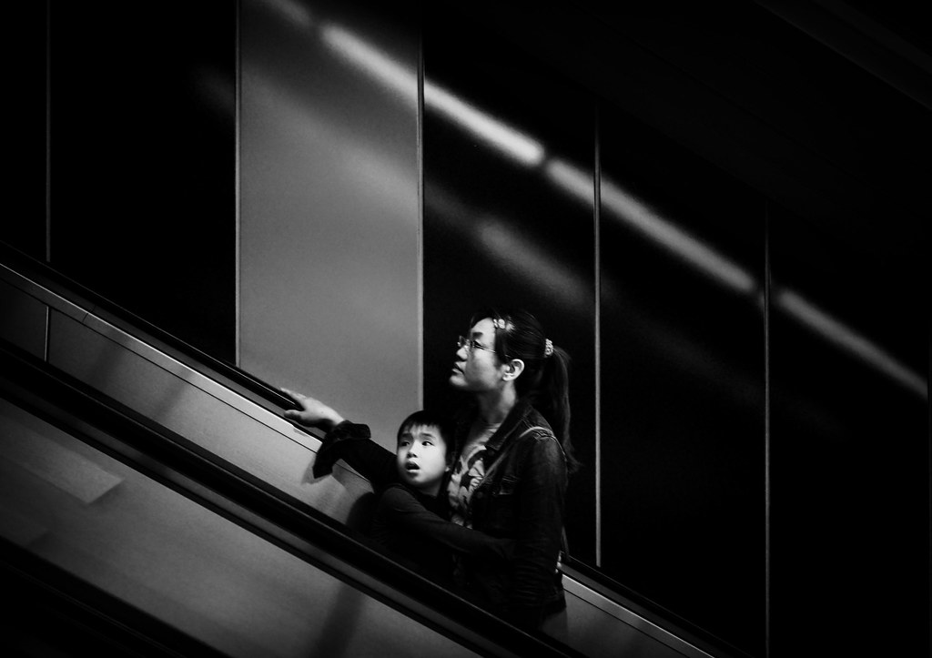 Mother and son ascending escalator at Houshanpi MRT station in Taipei