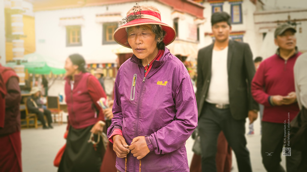 Tibet, candid shot of a woman immersed in thoughts and walking on the streets of Lhasa (Lhasa, China), 06-2016, 83 (Vlad Meytin, vladsm.com)