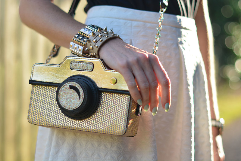 White skirt, camera cross body bag