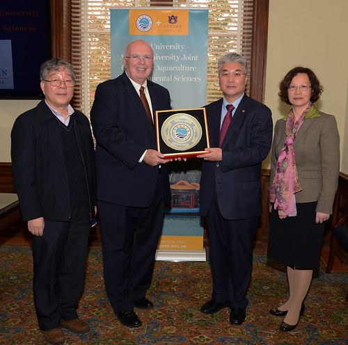 Pictured, from left, are Shuanglin Dong, OUC professor and former vice president; Timothy Boosinger, Auburn provost; Zhigang Yu, OUC president; and Wenhong Song, director of OUC's international office.