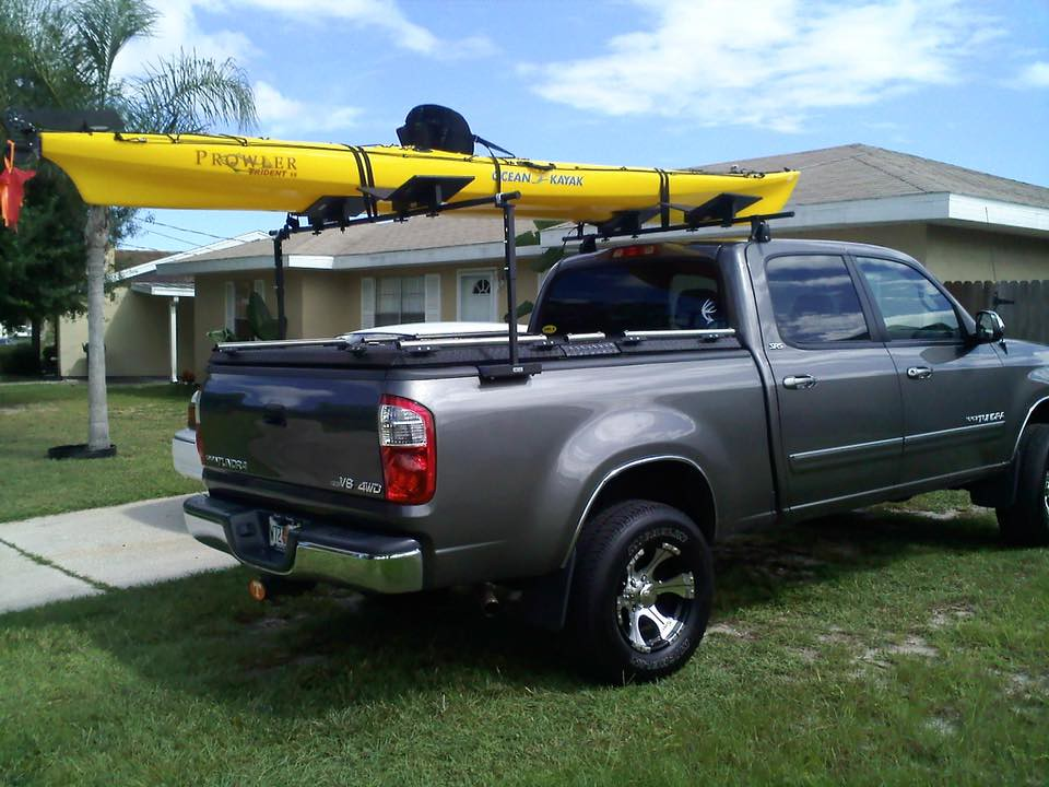 A Heavy Duty Truck Bed Cover And Kayak Rack On A Toyota Tu