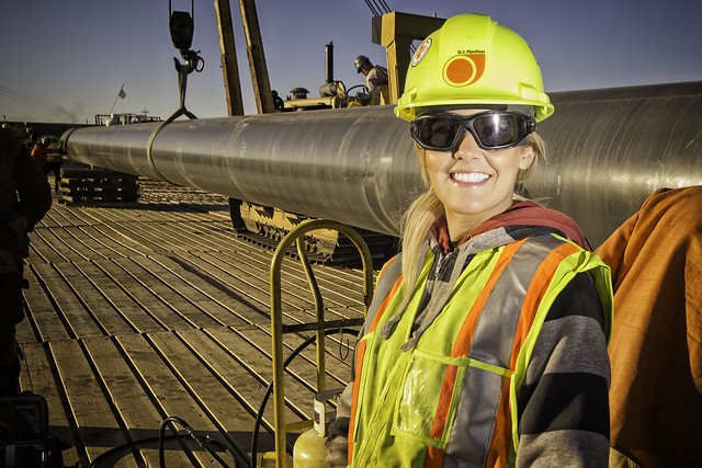 Photo of a female oil pipeline worker
