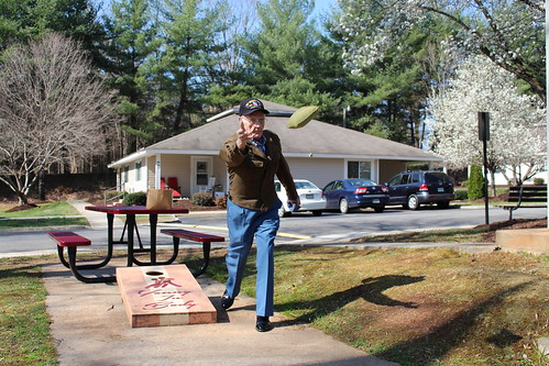 Henry Smith playing the lawn game Cornhole at Milnwood Village Apartments in Farmville