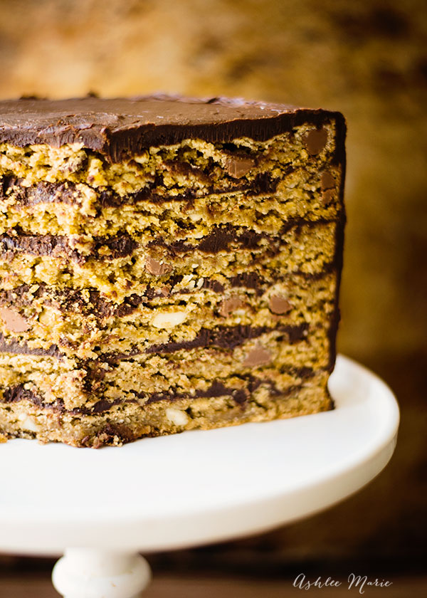 layers of oatmeal chocolate chip cookies (with macadamia nuts) and rich dark chocoalte ganache make this cake a dessert no one can pass up