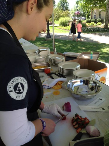 AmeriCorps VISTA summer associate Michal Elias-Bachrach serving summer meals to children