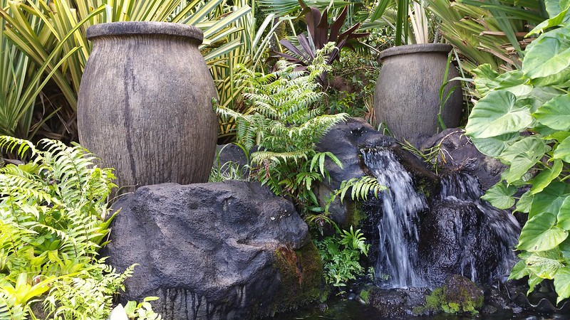 a waterfall between urns