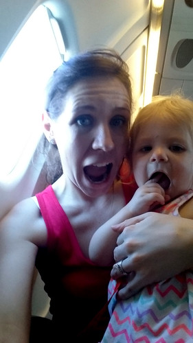 Millie and I later, on the plane, celebrating the fact that we got to go too. (Netherlands 2015)