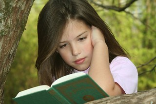 Ten year old girl reading book
