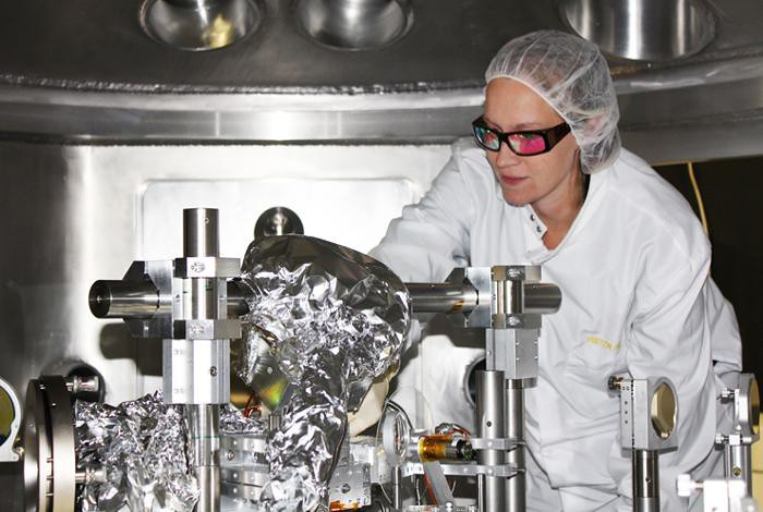 Arianna Gleason is seen making final adjustments to detector positions inside the Matter in Extreme Conditions (MEC) target chamber at the Stanford Liner Accelerator facility (SLAC) in California.