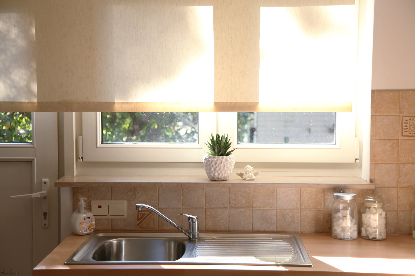 sunny september kitchen interior home sink window sun plants beige white light bright pale neutral cozy warm home decoration shabby chic