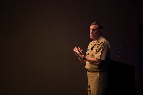 Navy Adm. Michael Rogers talks to an audience in an auditorium.