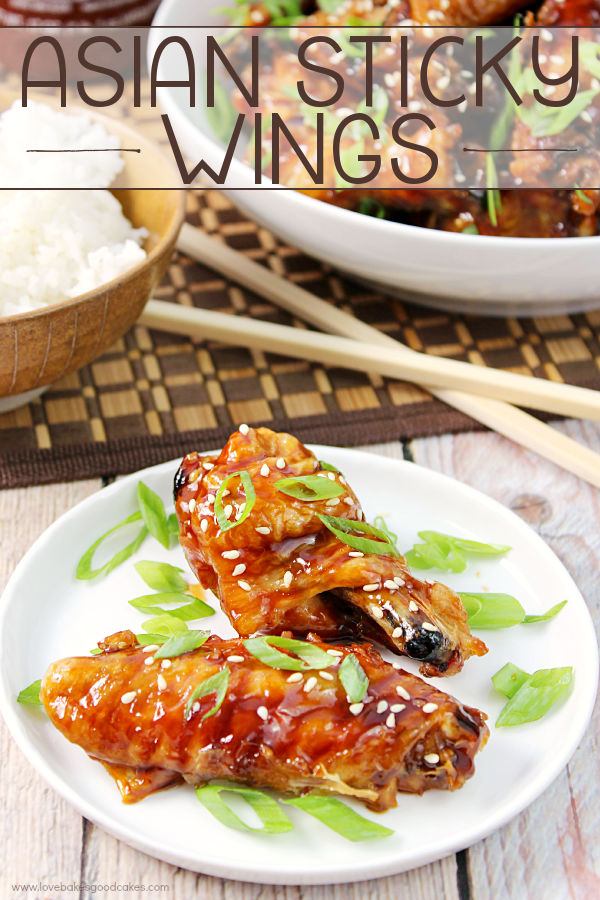 Asian Sticky Wings on a white plate with rice and chop sticks.